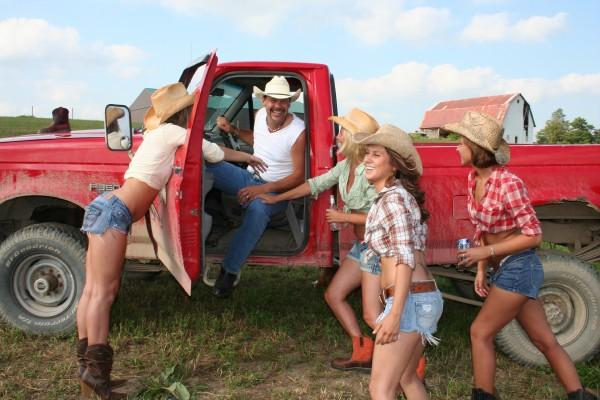 country girls next to a pickup